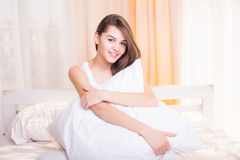 Pretty girl sitting on the bed Royalty Free Stock Photo
