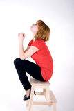 Pretty girl sitting on a chair Royalty Free Stock Photos