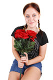 Pretty girl sitting on a chair with roses. Stock Photos