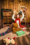 Pretty girl sitting with Christmas gifts stock image