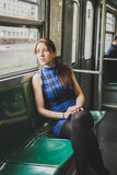 Pretty girl sitting inside subway train Stock Photography