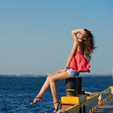 Pretty girl sitting at the old berth Royalty Free Stock Image