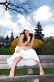 Pretty Girl Sitting On The Bench. Royalty Free Stock Photos