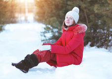 Pretty girl sitting on the snow Royalty Free Stock Image