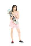 Pretty girl with a skate board Stock Photos