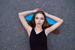 Pretty girl with skateboard Stock Photo
