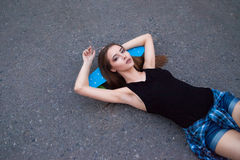 Pretty girl with skateboard Royalty Free Stock Photo
