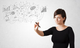 Pretty girl sketching graphs and diagrams on wall Stock Photography