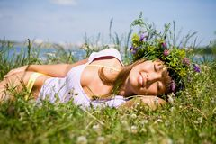 Pretty girl  sleep on field Royalty Free Stock Image