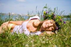 Pretty girl  sleep on field Royalty Free Stock Image
