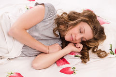 Pretty girl sleeping on the bed Stock Images