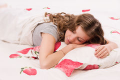 Pretty girl sleeping on the bed Stock Photos