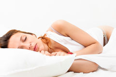 Pretty girl sleeping on white pillow Stock Photos