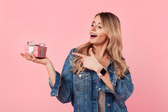 Pretty girl with small gift box Stock Photo