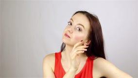 Pretty girl smartens at the mirror stock video