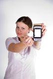 Pretty girl with a smartphone. On white and grey background royalty free stock photo