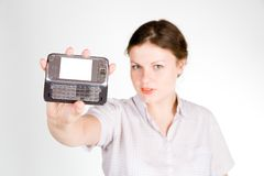 Pretty girl with a smartphone. On white and grey background royalty free stock photography