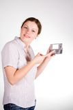 Pretty girl with a smartphone. On white and grey background stock photo