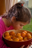 Pretty Girl Smelling Oranges Stock Photography