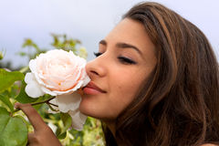 Pretty Girl Smelling Rose in Paris Stock Images