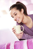 Pretty girl smiles at the laptop Royalty Free Stock Photos