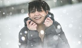Pretty girl smiling Amused. Close-up portrait of a young girl in the snow smiling amused royalty free stock photos
