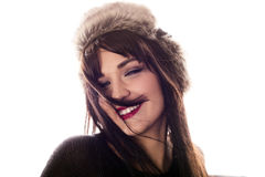 Pretty girl smiling. Beautiful woman in a fur hat smiling Royalty Free Stock Images