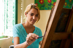 Pretty Girl Smiling And Painting At Art School Royalty Free Stock Image