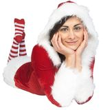 Pretty girl smiling in santa outfit Royalty Free Stock Photography