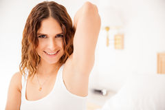 Pretty girl with smooth armpits Stock Images