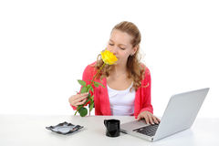 Pretty girl sniffing yellow rose. Stock Photography
