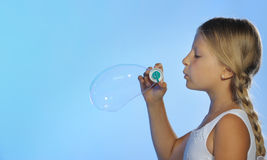 The pretty girl with soap bubbles Royalty Free Stock Photos