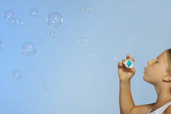 The pretty girl with soap bubbles Royalty Free Stock Photography
