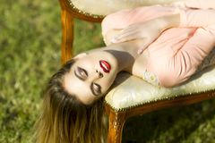 Pretty girl on sofa outdoor Royalty Free Stock Image