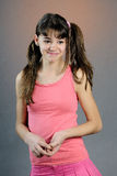 Pretty girl in sport clothes. Pretty girl in pink sport clothes and having long hair Royalty Free Stock Photography