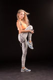 Pretty girl sprained foot by rope. Caucasian fitness girls, isol Stock Photography