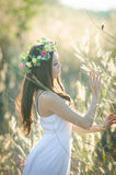 Pretty girl in a spring  flower garden Royalty Free Stock Image