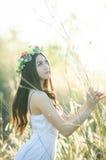 Pretty girl in a spring  flower garden Stock Photos
