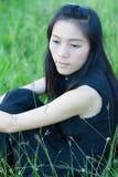 Pretty girl in a spring flower garden Stock Image