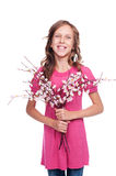 Pretty girl with spring flowers Stock Image