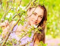 Pretty girl in spring garden Royalty Free Stock Photo