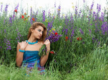 Pretty girl in spring meadow Stock Photos