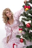 Pretty girl stand near a Christmas tree Stock Photography