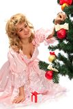 Pretty girl stand near a Christmas tree Stock Photos
