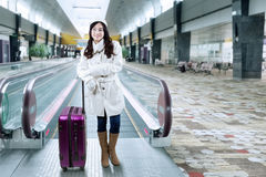 Pretty girl standing at airport hallway Royalty Free Stock Images