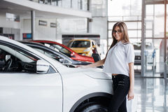 Pretty girl is standing near her car. Royalty Free Stock Photography