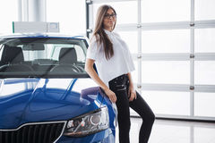 Pretty girl is standing near her car. Royalty Free Stock Photos