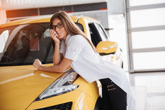 Pretty girl is standing near her car. Stock Image