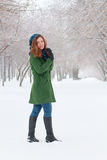 Pretty girl stands outdoor at winter day in park Stock Images