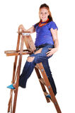 Pretty girl on the stepladder. Stock Photos